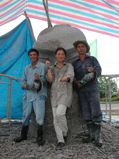 Two stone workers and Zhang Yaxi in front of the General Ba sculpture - December 2003, Vietnam