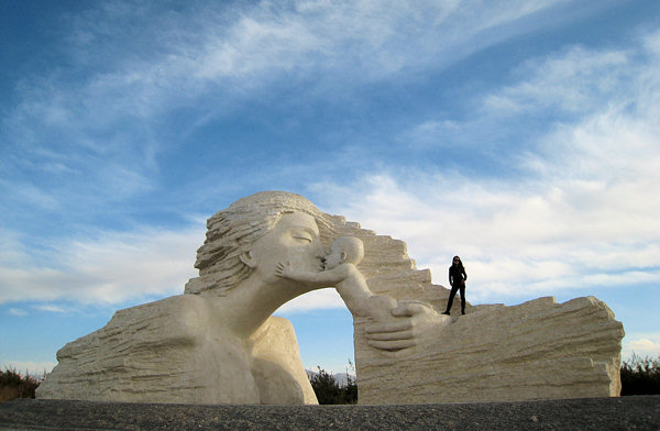 Zhang Yaxi stands on top of her completed monumental sculpture in Qinghai